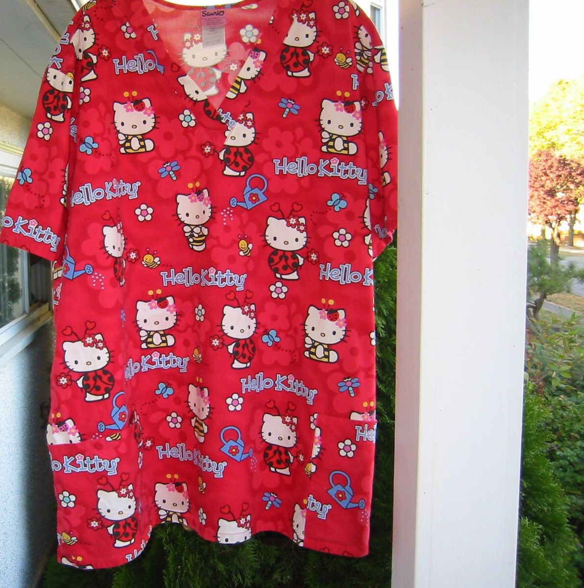 Sanrio Hello Kitty Red flower print scrub top flowers, bees, ladybugs